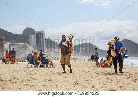 Rio De Janeiro, Brazil - 17.11.2019: Merchant At Copacabana Beach.