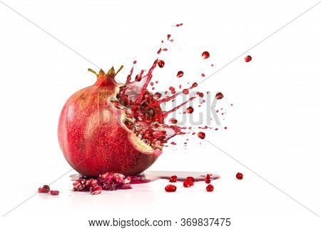 Pomegranate Explosion Juice Seeds On A White Background