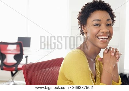 Portrait of young attractive african woman in office