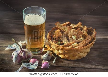 A Bouquet Of Fresh Beer And Snacks With Homemade, Salted, Rye Rusks With Garlic For Beer, Lie On A W