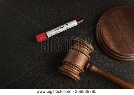 Judges Gavel Or Mallet Law And Infected Blood Sample In Sample Tube Covid 19.