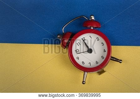 Ukrainian Flag And Vintage Alarm Clock, Close Up. Time To Learn Ukrainian. Time To Travel Around Ukr