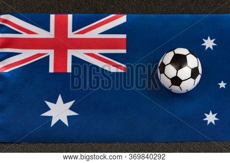 Flag Of Commonwealth Of Australia Close Up And Little Toy Ball. Australia Football.