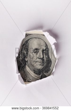 Benjamin Franklin Face Through Hole In Paper