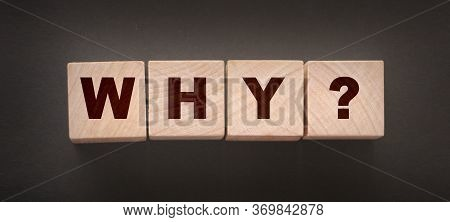Why Closeup Of Word With Question Mark On Wooden Cubes On Dark Grey Desk Background. Reason Why Busi