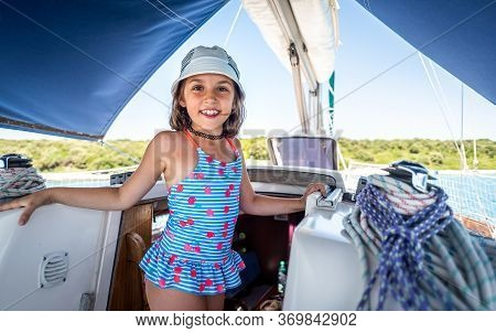 Child On Sailing Boat Yacht Summer Vacation Adventure.