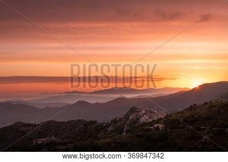 Sunrise Over Speloncato And Coastline Of Corsica