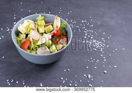 Fattoush Vegetarian Salad In A Gray Bowl Against Black Background. Copy Space. Close Up. Levantine S