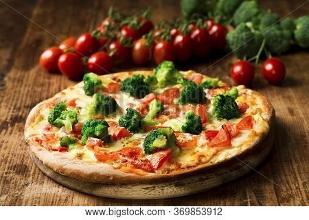 Fresh Baked Pizza With Broccoli Florets, Sliced Tomatoes Drizzled With Hollandaise Sauce