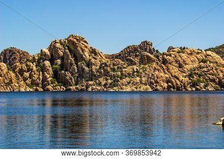 Blue Mountain Lake With Unique Rock Formation Shoreline