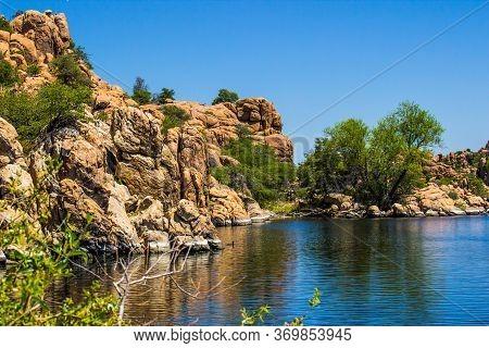 Geological Rock Formation Shoreline At Mountain Lake