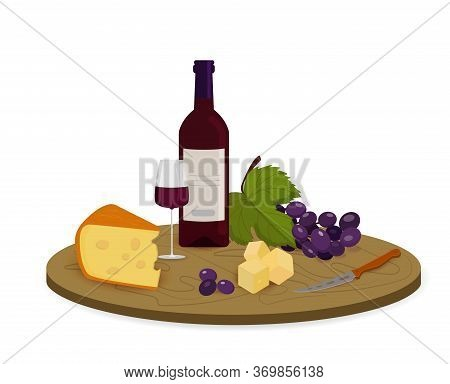 A Piece Of Cheese With A Bottle, A Glass Of Red Wine And Red Grapes On A Wooden Board.