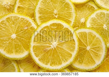 Lemon Background. Top View Of Round Slices.