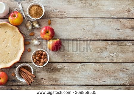 Food Wooden Background With  Cooking Tray With Dough, Red Apples And Baking Ingredients On Natural W