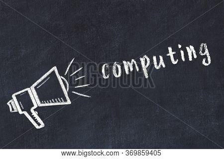 Chalk Drawing Of Loudspeaker And Handwritten Inscription Computing On Black Desk