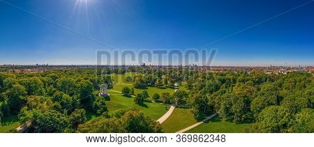 Beautiful View From An Drone Over Munich With Its Green Englischer Garten, A Park With Many Trees An