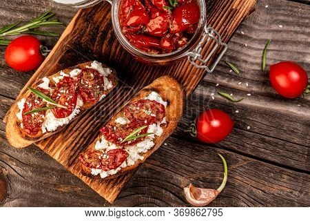 Tasty Savory Italian Appetizers, Or Bruschetta, On Slices Of Toasted Baguette Garnigoat Cheese, Sun-