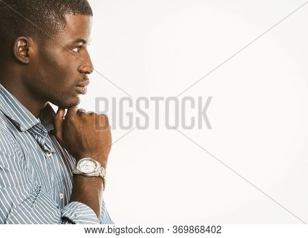 Pensive African American Businessman Touches His Chin With Hand With Luxury Wristwatch. Creative Guy