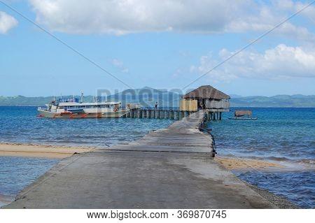 Palawan, Ph - Nov 30 - Boat Dock,hut Facade And Pathway At Dos Palmas Island Resort On November 30,