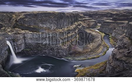Photo Of The Palouse Falls At The Sunset Time. State Of Washington In The Usa.