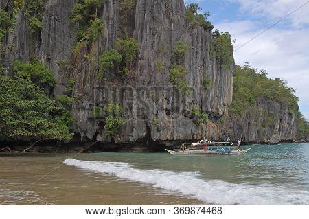 Palawan, Ph -  Nov 29 - Limestone Rock Formation, Sea And Boat On November 29, 2009 In Puerto Prince