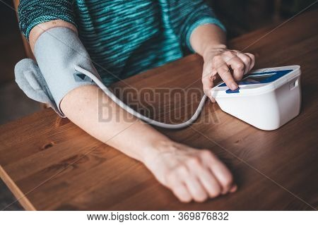 Woman Health Check Blood Pressure And Heart Rate At Home With Digital Pressure, Health And Medical C