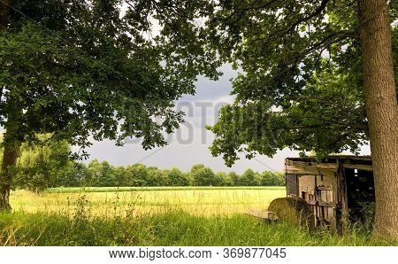 Threatening Dark Rainy Clouds Are Covering A Rural Landscape, Showing The Overcast And Gloomy Sky Ab