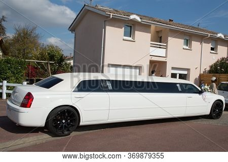 Bordeaux , Aquitaine / France - 11 07 2019 : Cream White Stretched Limousine For Celebrities Wedding