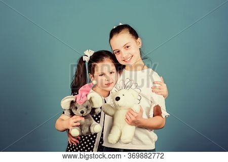 Love And Friendship. Kids Adorable Cute Girls Play With Soft Toys. Happy Childhood. Child Care. Sist