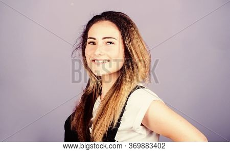 Woman Smiling Face Posing With Stylish Hairstyle On Violet Background. Voluminous Crimped Hair. Tren