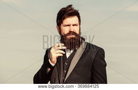 Relaxing But Harmful Habit. Man With Beard And Mustache Hold Cigarette. Bearded Hipster Smoking Ciga