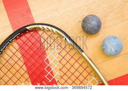 Close Up Of A Squash Racket And Ball On The Wooden Background, Sport Concept
