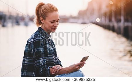 Woman Tourist Photographing Beautiful Sea Landscape On Cell Telephone