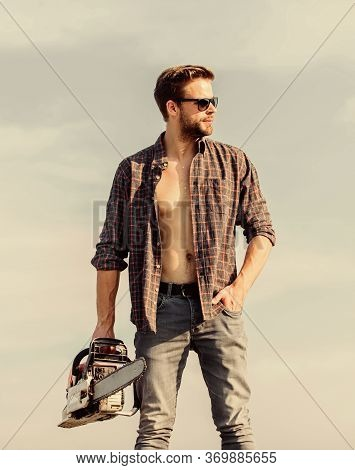Dangerous Job. Feeling Confident. Risky Temper. Powerful Chainsaw. Sharp Blade. Handsome Man With Ch