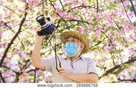 Tourist Camera Photo. Nature Photography. Senior Man Respirator Mask. Professional Photographer Work