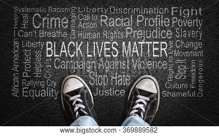 Person Standing Over Black Lives Matter Word Cloud. Concept Of Stopping Racism Against People Of Col