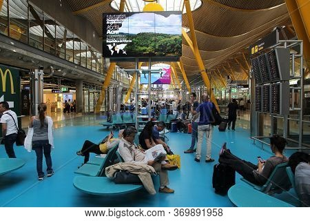 Madrid, Spain - October 20, 2014: Passengers Visit Terminal 4 Of Madrid Barajas Airport. The Famous