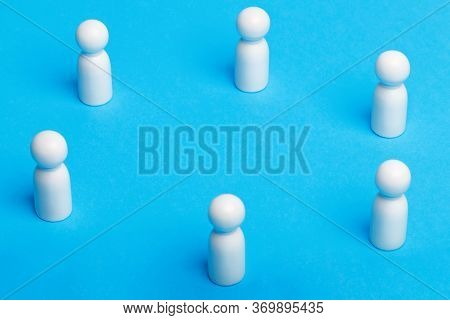 Social Distancing Conceptual Image. White Wooden Figures Of People Keep Distance On Blue Background