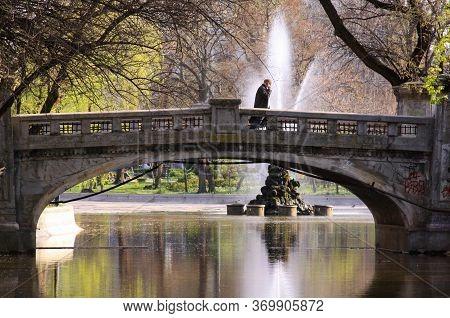 Bucharest, Romania - April 13, 2020: Business Man Walking On Bridge In Cismigiu Park, Bucharest, Rom