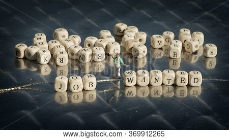 Miniature Model Of People And Wooden Cubes With Job Wanted Inscription Strung On A Thread On Reflect