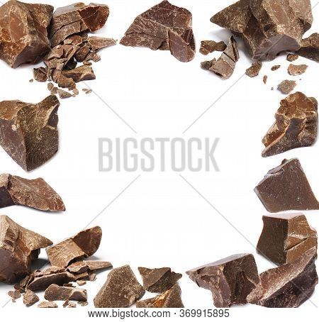 Frame Made Of Delicious Chocolate Chunks On White Background. Space For Design