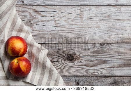 Wooden Background With Smooth Peaches At Towel. Free Space For Text. Top View, Flat Lay. Concept Of