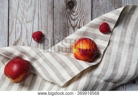 Fresh Tasty Peaches With Raspberry On Wooden Background. Concept Of Healthy Summer Food At Wood Back