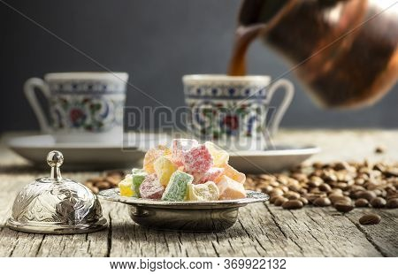 Turkish Delight In Hollowware And Pouring Turkish Coffee In Porcelain Cup, Traditional Fruity Flavor