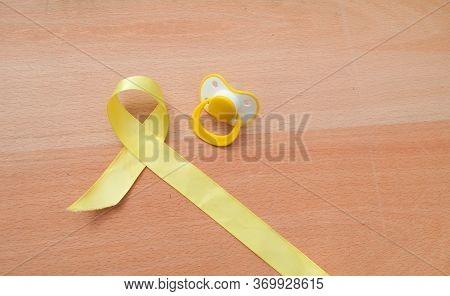 Yellow Gold Ribbon, Childhood Cancer Awareness. International Childhood Cancer Day.