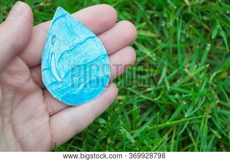 Hand Holds A Drop Of Water, World Hand Hygiene Day. World Water Day, Clean Water And Sanitation, Han