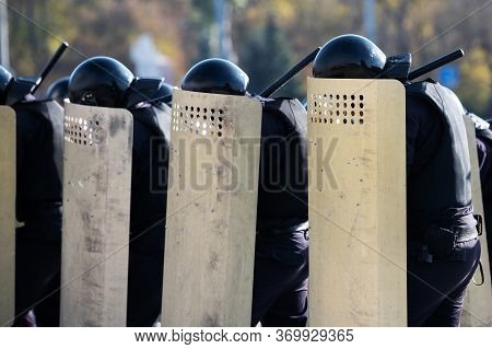 Riot Police Are Protected By Shields And Helmets On The Streets During The Riots