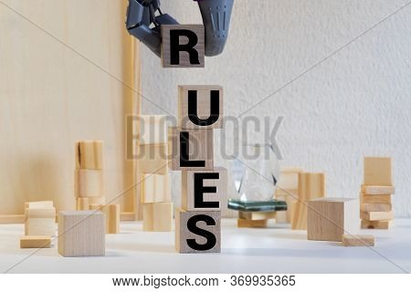 Closeup Of Word On Wooden Cube On Wooden Desk Background Concept - Rules