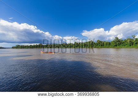 Paramaribo, Suriname - August 2019: Traditional Boat With Passengers Sailing Along The Suriname Rive