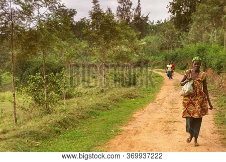 Masaka,rwanda - October 21,2017:a Path Outside A Young African Woman Was Walking Home From Her Worki